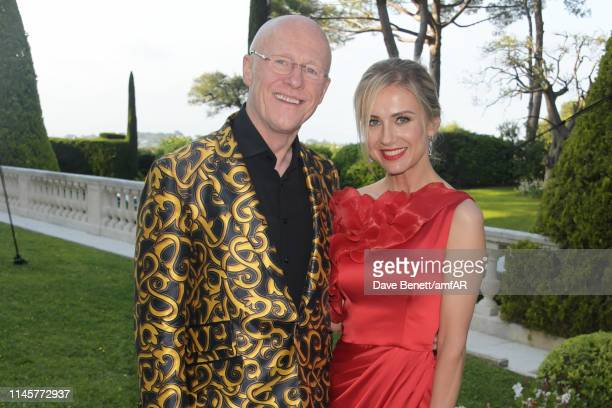 John Caudwell and Modesta Vzesniauskaite attend the amfAR Cannes Gala 2019 at Hotel du CapEdenRoc on May 23 2019 in Cap d'Antibes France