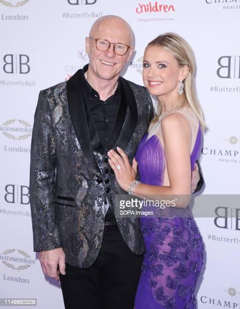 John Caudwell and Modesta Vzesniauskaite attending the Butterfly Ball 2019 at Grosvenor House in London.