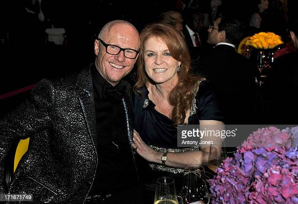 John Caudwell (L) and Sarah Ferguson, Duchess of York, attend the 15th Annual White Tie and Tiara Ball to Benefit Elton John AIDS Foundation in Association with Chopard at Woodside on June 27, 2013 in Windsor, England. No sales to online/digital media worldwide until the 14th of July. No sales before July 14th, 2013 in UK, Spain, Switzerland, Mexico, Dubai, Russia, Serbia, Bulgaria, Turkey, Argentina, Chile, Peru, Ecuador, Colombia, Venezuela, Puerto Rico, Dominican Republic, Greece, Canada, Thailand, Indonesia, Morocco, Malaysia, India, Pakistan, Nigeria. All pictures are for editorial use only and mention of 'Chopard' and 'The Elton John Aids Foundation' are compulsory. No sales ever to Ok, Now, Closer, Reveal, Heat, Look or Grazia magazines in the United Kingdom. No sales ever to any jewellers or watchmakers other than Chopard.