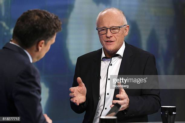 John Caudwell billionaire and founder of Phones4U Ltd gestures as he speaks during a Bloomberg Television interview in London UK on Wednesday March 2...