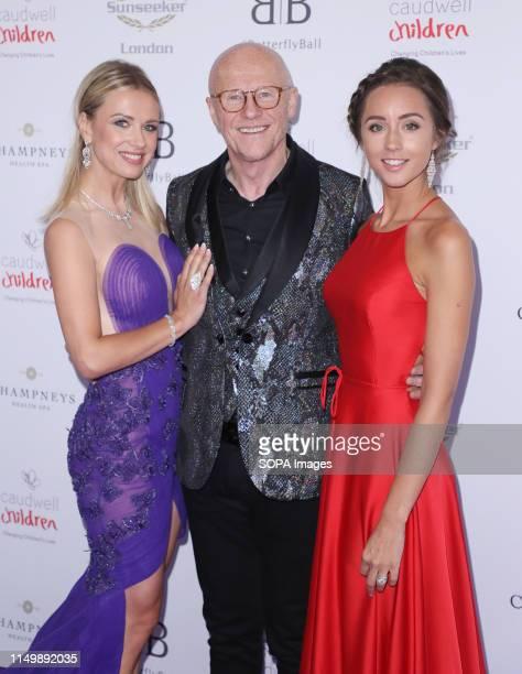 John Caudwell Modesta Vzesniauskaite and Emily Andre attending the Butterfly Ball 2019 at Grosvenor House in London