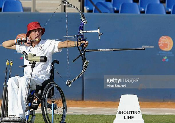 John Cavanagh of Great Britain in action during the men's individualW1 archery competition on September 24 2004 at the 2004 Athens Paralympic Games