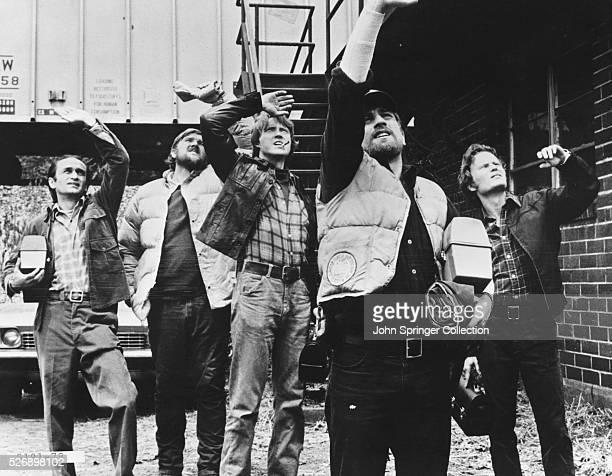 John Cazale as Stan, Chuck Aspegren as Axel, Christopher Walken as Nick, Robert De Niro Michael Vronsky, John Savage as Steven in the 1978 film The...
