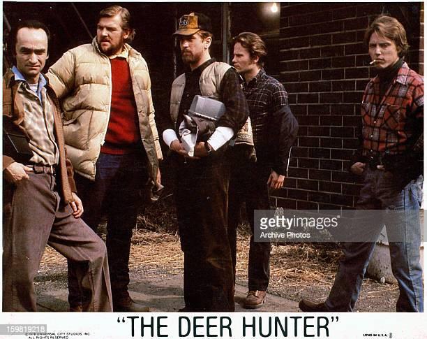 John Cazale, Chuck Aspegren, Robert De Niro, John Savage, and Christopher Walken standing together in a scene from the film 'The Deer Hunter', 1978.