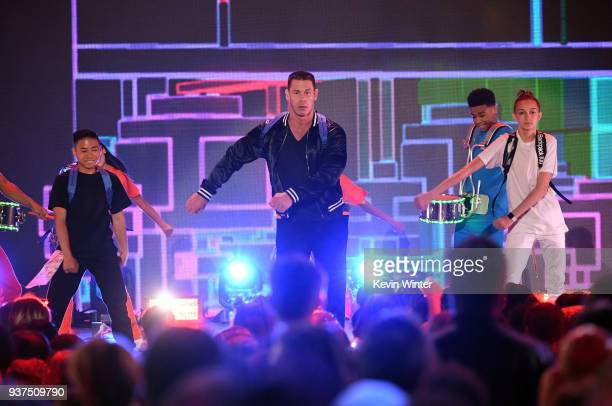 John Cena and Backpack Kid perform onstage at Nickelodeon's 2018 Kids' Choice Awards at The Forum on March 24 2018 in Inglewood California