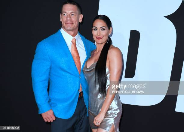 John Cena and Nikki Bella arrive for the premiere of Blockers in Los Angeles California on April 3 2018 / AFP PHOTO / Frederic J Brown
