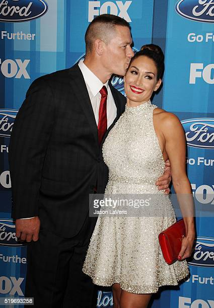John Cena and Nikki Bella attend FOX's 'American Idol' finale for the farewell season at Dolby Theatre on April 7 2016 in Hollywood California
