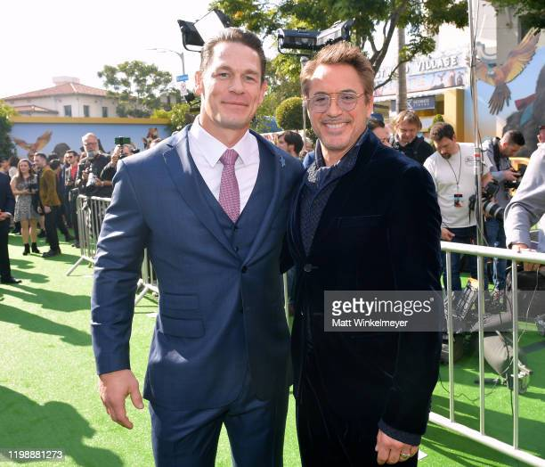 John Cena and Robert Downey Jr attend the Premiere of Universal Pictures' Dolittle at Regency Village Theatre on January 11 2020 in Westwood...