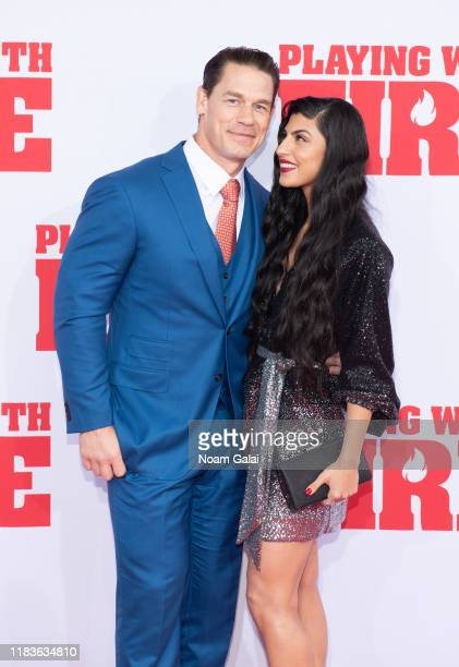 John Cena and Shay Shariatzadeh attend the Playing With Fire New York premiere at AMC Lincoln Square Theater on October 26 2019 in New York City