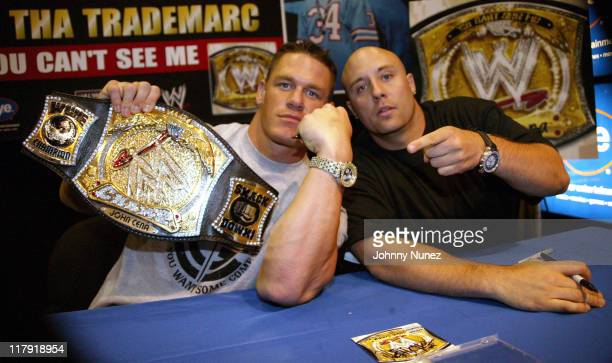 John Cena and Tha Trademarc during John Cena Signs 'WrestleMania 21' DVD and His Rap CD at FYE May 12 2005 at FYE in New York New York United States