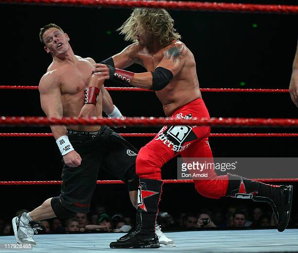 John Cena appears rattled by this blow from Edge Lita during the WWE RAW Superslam event at Acer Arena Homebush Stadium in Sydney on August 4 2006