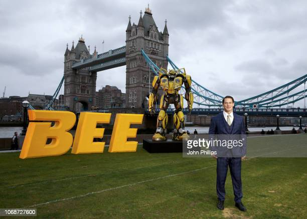 John Cena attends a photocall in support of Paramount Pictures' film 'Bumblebee'â at Tower Bridge, Potters Field Park on December 5, 2018 in London,...