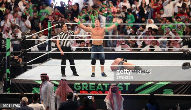 John Cena celebrates defeating Triple H during the World Wrestling Entertainment Greatest Royal Rumble event in the Saudi coastal city of Jeddah on...