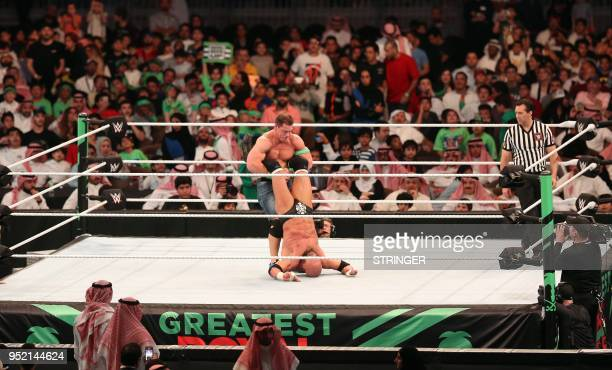 John Cena competes with Triple H during the World Wrestling Entertainment Greatest Royal Rumble event in the Saudi coastal city of Jeddah on April 27...