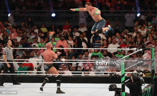 TOPSHOT John Cena competes with Triple H during the World Wrestling Entertainment Greatest Royal Rumble event in the Saudi coastal city of Jeddah on...