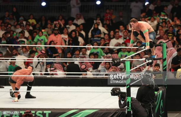 John Cena competes with Triple H during the World Wrestling Entertainment Greatest Royal Rumble event in the Saudi coastal city of Jeddah on April...