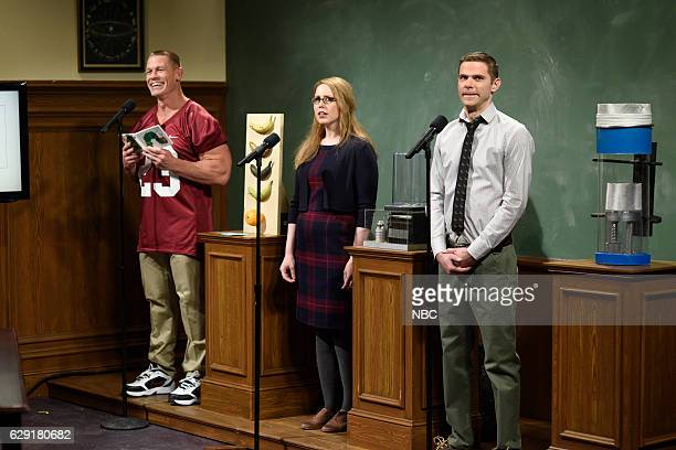 LIVE 'John Cena' Episode 1713 Pictured John Cena Vanessa Bayer and Mikey Day during the 'Science Presentation' sketch on December 10 2016