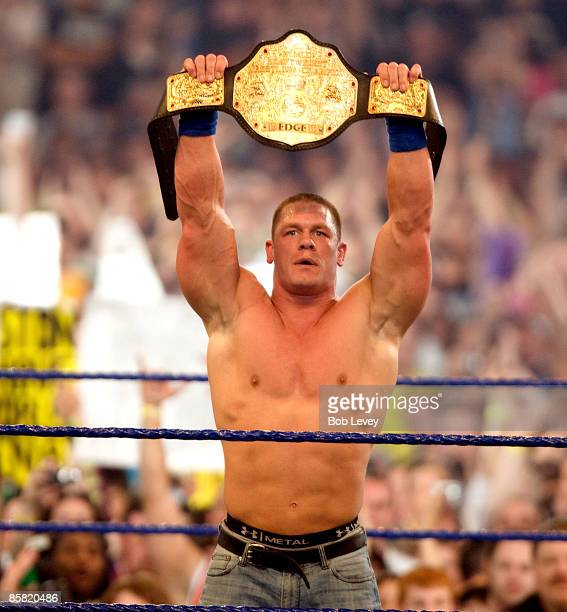 John Cena shows off his new World Heavyweight Championship belt after defeating The Big Show and Edge in triple threat match at WrestleMania 25 at...