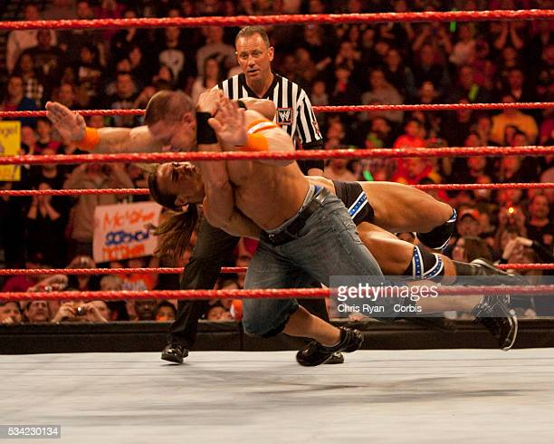John Cena takes a beating at the hands of Drew McIntyre during WWE's Monday Night Raw at Rose Garden arena in Portland