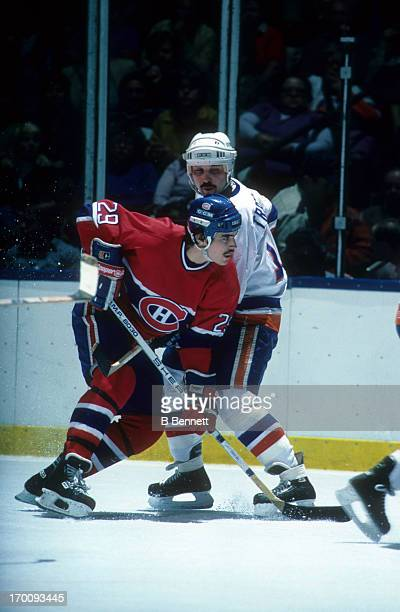 John Chabot of the Montreal Canadiens is defended by Bryan Trottier of the New York Islanders during the 1984 Conference Finals in May 1984 at the...