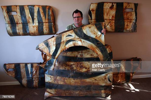 John Chalmers stands with a wing he saved from a wrecked car that was left in a quarry and painted by the guerrilla artist Banksy and features in his...