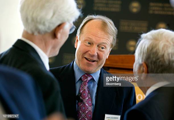 John Chambers, chairman and chief executive officer of Cisco Systems Inc., center, speaks with Peter Lynch, vice chairman of Fidelity Management and...
