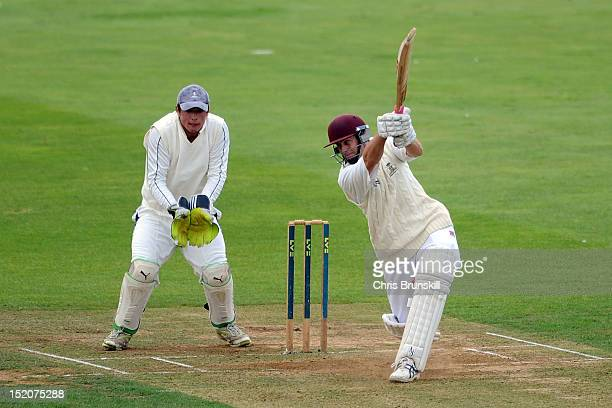 John Chambers of Wanstead Snaresbrook hits out to the boundary during the Kingfisher Beer Cup Final between York and Wanstead Snaresbrook at The...
