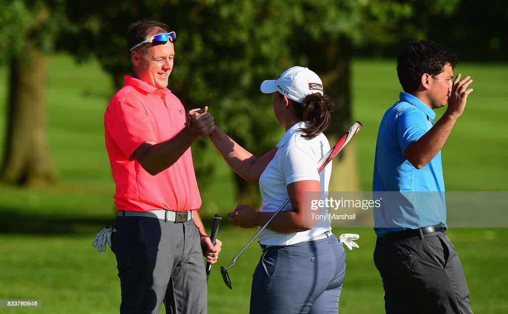 John Cheetham and Olivia Raybould of Three Hammers Golf Complex shake hands at the end of their second round during the Golfbreaks.com PGA Fourball Championship - Day 2 at Whittlebury Park Golf & Country Club on August 17, 2017 in Towcester, England.