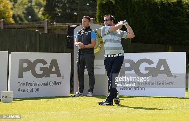 John Cheetham of Three Hammers Golf Complex watches as Simon Shepherd of Addington Court Golf Club plays his first shot on the 1st tee during the PGA...