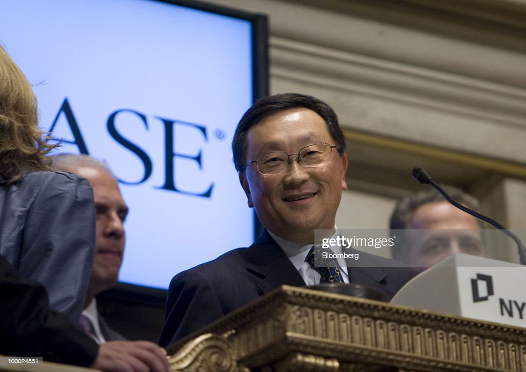 John Chen, chairman, chief executive officer and president of Sybase Inc., rings the closing bell at the New York Stock Exchange in New York, U.S., on Thursday, May 20, 2010. Chen said in an interview with CNBC that he thinks the deal with SAP AG will 'get done.' Photographer: Jin Lee/Bloomberg via Getty Images