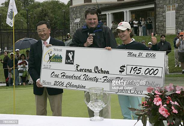 John Chen of Sybase presents Lorena ochoa with the winner's check during the final round of the 2006 Sybase Classic at Wygakyl Country Club in New...