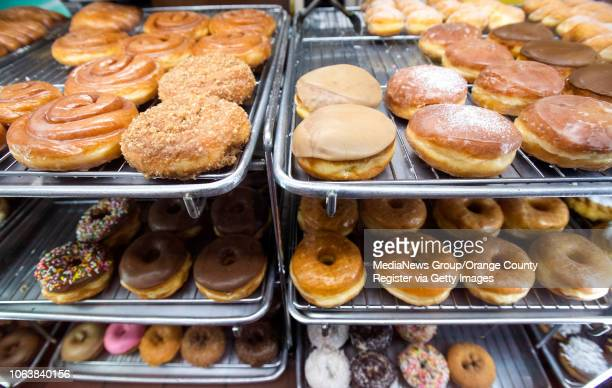 John Chhan makes donuts each day and closes when he sells out at Donut City in Seal Beach CA on Monday October 29 2018 John's wife Stella suffered an...