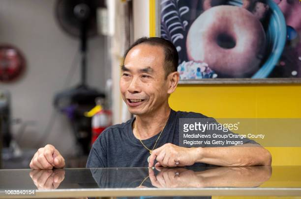 John Chhan works the counter at Donut City in Seal Beach CA on Monday October 29 2018 John's wife Stella suffered an aneurysm in September Their...