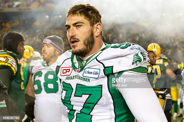 John Chick of the Saskatchewan Roughriders walks on the field after the CFL Western SemiFinal game between the Saskatchewan Roughriders and Edmonton...