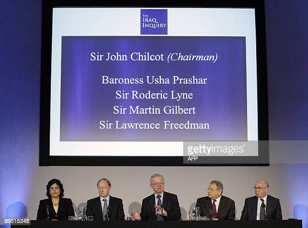 John Chilcot, the chairman of the Iraq Inquiry, sits with committee members Baroness Usha Prashar, Roderic Lyne, Martin Gilbert, and Lawrence...