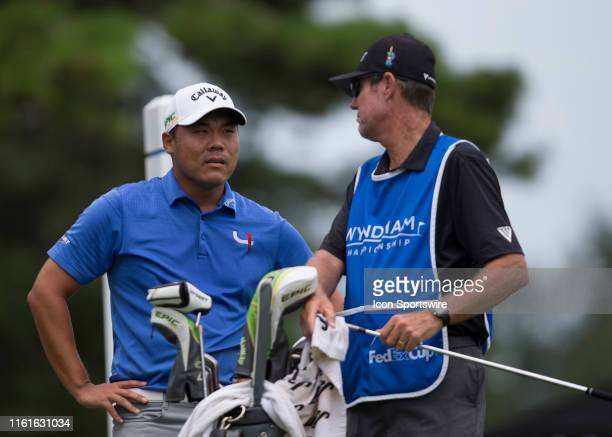 John Chin and his caddie Don Donatello during the final round of the Wyndham Championship on August 04 2019 at Sedgefield Country Club in Greensboro...