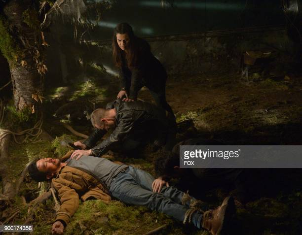 John Cho Ben Daniels and Zuleikha Robinson in the season finale 'Unworthy' episode of THE EXORCIST airing Friday Dec 15 on FOX