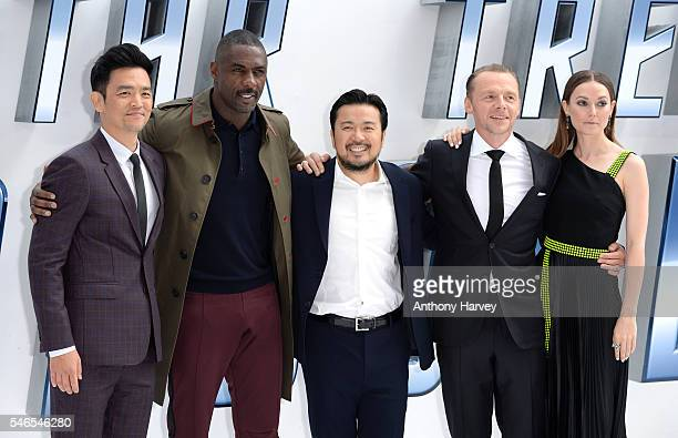 John Cho Idris Elba Director Justin Lin Simon Pegg and Lydia Wilson attend the UK premiere of 'Star Trek Beyond' on July 12 2016 in London United...