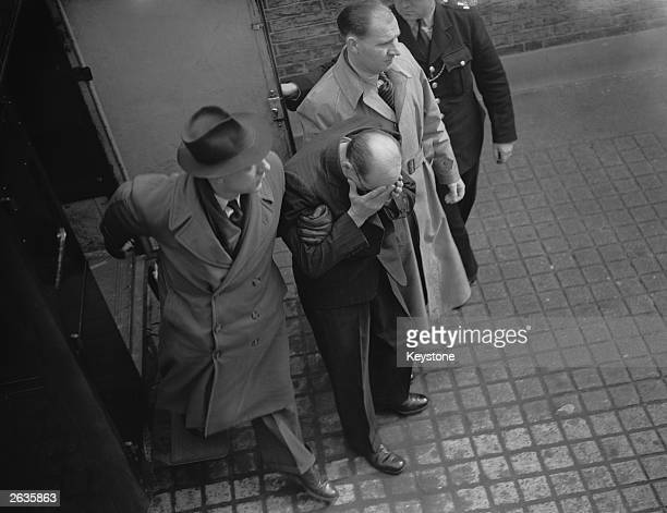 John Christie arriving at court in London to face four charges of murder, 8th April 1953.