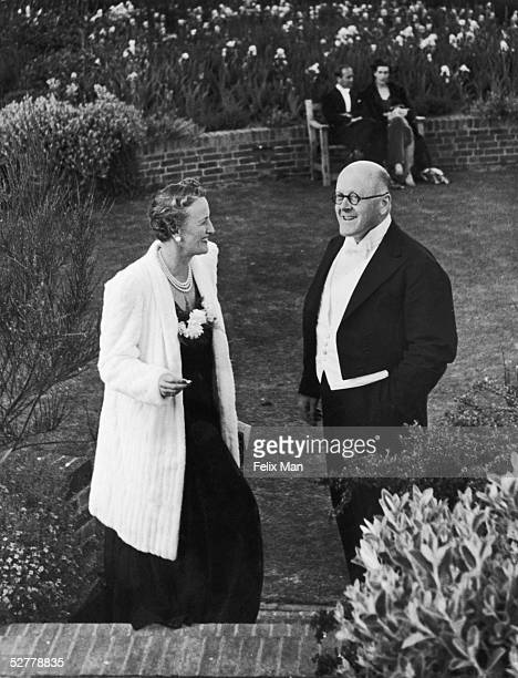 John Christie founder of the Glyndebourne opera festival in conversation with Mrs Philip Hill during one of the summer performances 17th June 1939...