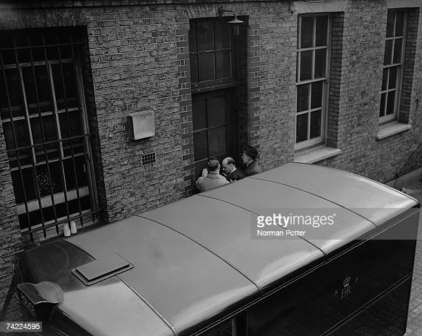 John Christie is taken into West London Police Court for his second remand hearing 8th April 1953 Christie is accused of his wife's murder at 10...