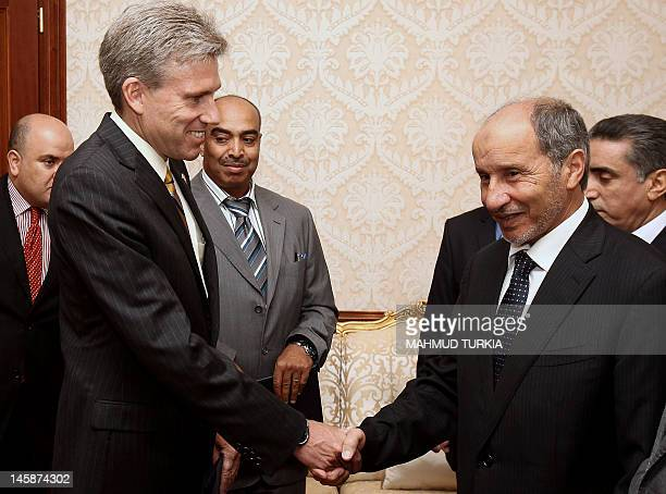 John Christopher Stevens, newly appointed US ambassador to Libya, shakes hands with Libyan National Transitional Council chairman Mustafa Abdel Jalil...