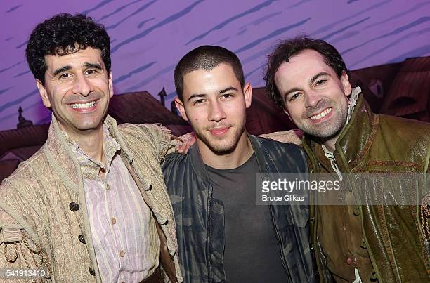 John Ciriani Nick Jonas and Rob McClure pose backstage at the hit musical Something Rotten on Broadway at The StJames Theatre on June 20 2016 in New...