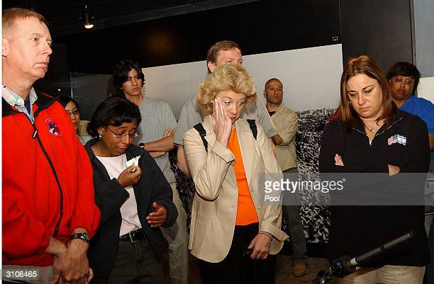John Clark Sandy Anderson Evelyn Husband and Rona Ramon families of the astronauts who died in the space shuttle Columbia visit a special exhibit...