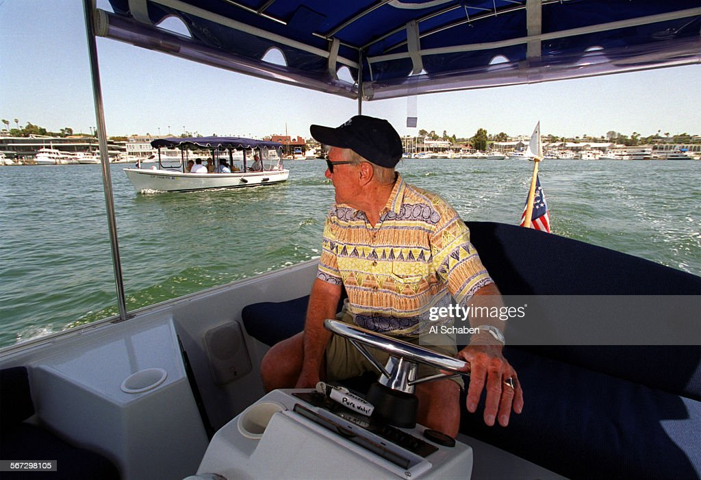 Beach John Clark Steers A 21 Foot Electric Duffy Boat As He