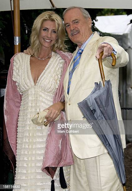 John Cleese And Lisa Hogan Arrives At A Garden Party Held By David Frost Each Year Near His London Home