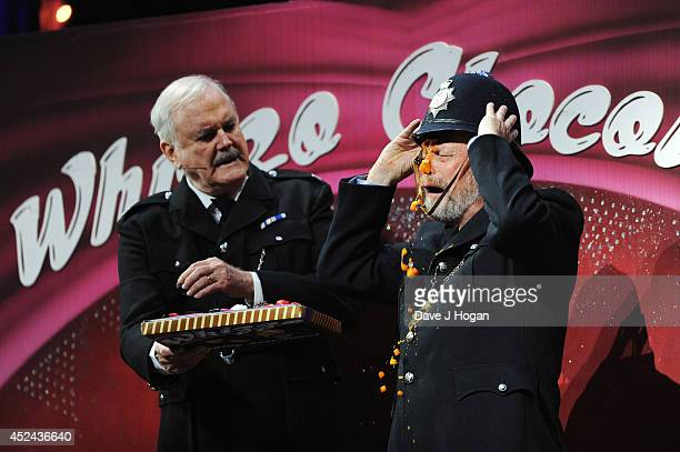 John Cleese and Terry Gilliam perform on the closing night of 'Monty Python Live ' at The O2 Arena on July 20 2014 in London England