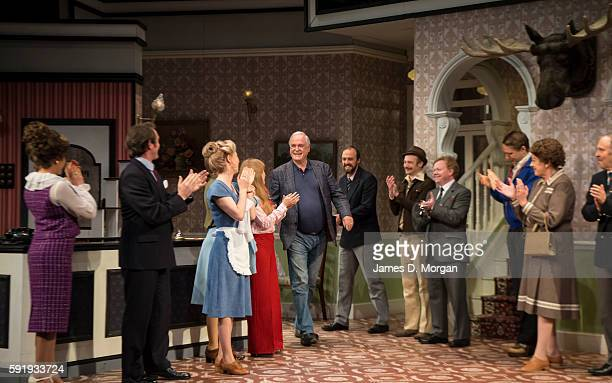 John Cleese who wrote the original BBC comedy series of Fawlty Towers enters the stage and is applauded by the cast during a media call at the Rosyln...