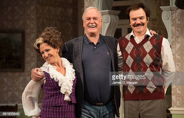 John Cleese who wrote the original BBC comedy series of Fawlty Towers with actors Blazey Best who plays Sybil and Stephen Hall who plays Basil during...