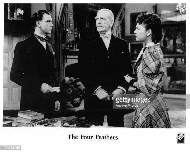 John Clements is looked at by C Aubrey Smith and June Duprez in a scene from the film 'The Four Feathers' 1939